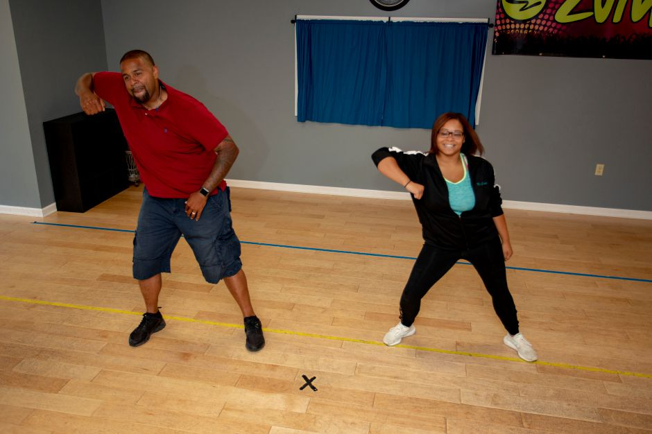 "Chloie McMahon, Higher Movement dancing instructor, and Meriden Police Officer Joseph Stoute practce their routine for ""Dancing with the Stars of Meriden,"" which raises money for Seniors Have Dreams, Too, an organization that grants wishes to senior citizens. 