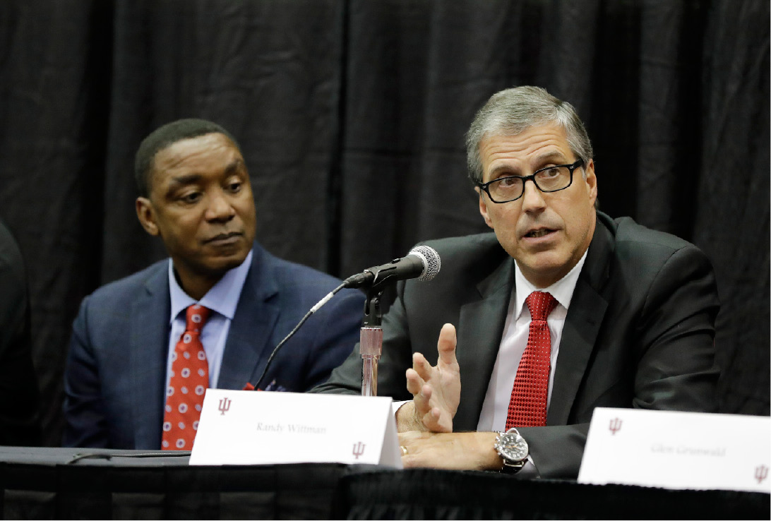 Former Indiana basketball player Randy Wittman speaks as Isiah Thomas listens during a news conference before an NCAA college basketball game between Indiana and North Carolina, Wednesday, Nov. 30, 2016, in Bloomington, Ind. Members of the 1981 NCAA men