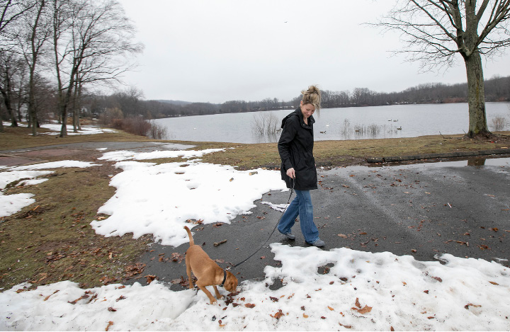 Kristiina Kennedy, of Meriden, walks her dog, Marley, at Beaver Pond in Meriden on Monday. Park department officials say the city's planned dog park at Beaver Pond could open in the fall if funding is approved in the next fiscal year budget. | Dave Zajac, Record-Journal