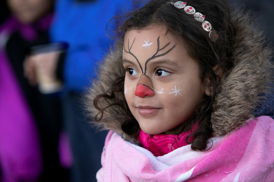 Emma Martinez, 5, of Meriden, dons a Rudolph the Red-Nosed Reindeer painted face during a Parks and Recreation Department hosted ugly holiday sweater party at Hubbard Park in Meriden Fri., Dec. 7, 2018. Dave Zajac, Record-Journal