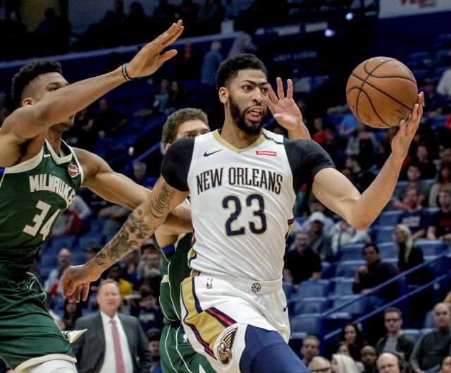 In this March 12, 2019, photo, New Orleans Pelicans forward Anthony Davis takes an outlet pass in a game against the Bucks in New Orleans. Associated Press