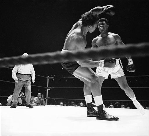 Challenger Cleveland Williams drops to the canvas for second time in second round after Muhammad Ali) Cassius Clay hit him with a left and right combination on Nov. 14, 1966 in Houston. Ali retained his heavyweight title with a third round technical knockout after downing Williams three times in second round and one in the third. (AP Photo)