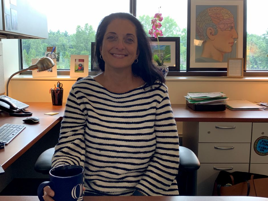 Photo of Dr. Marquis-Eydman in her office at the Frank H. Netter MD School of Medicine at Quinnipiac