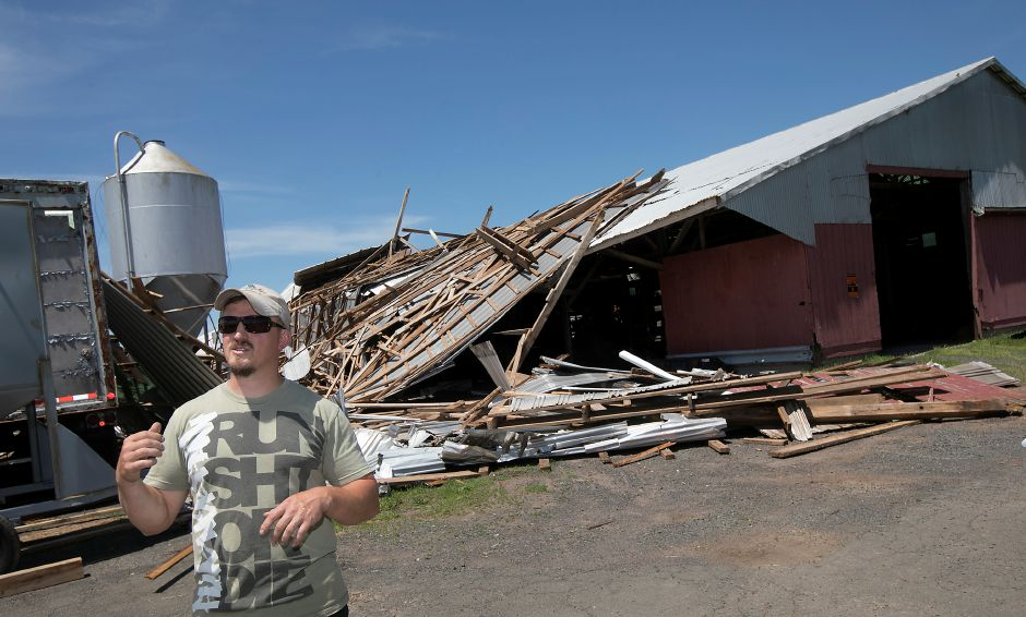 Local farmer Chris Wellington talks about damage to barns during last Tuesday