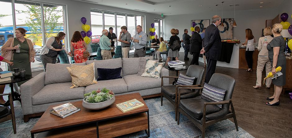 Local officials and guests gather in the Community Room at the Meriden Commons, Tuesday, July 24, 2018. State and local leaders, and developers celebrated the completion of the $25 million mixed income Meriden Commons I project and the start of construction on Meriden Commons II. About 100 people attended the ribbon cutting ceremony at the amphitheater on the Meriden Green. Dave Zajac, Record-Journal