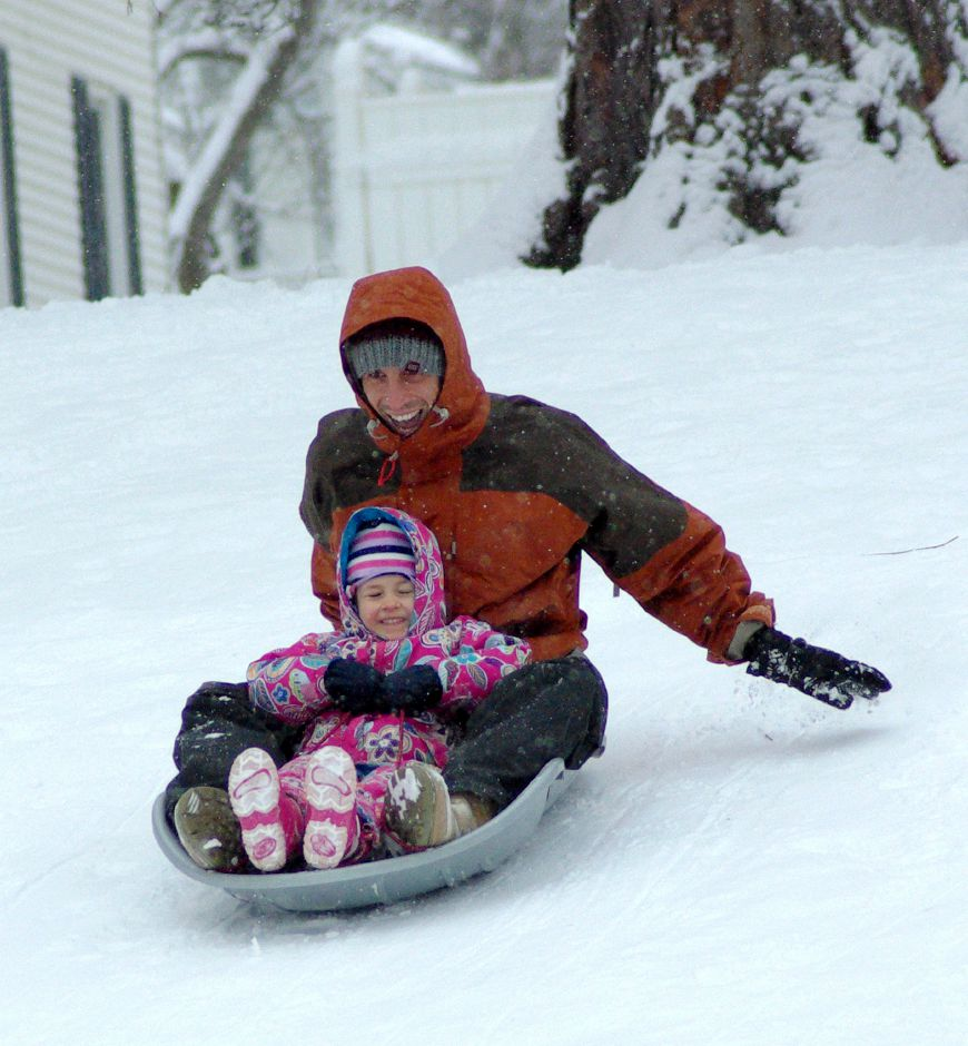 WESTERLY- Ted Rice and his Daughter Ruby Rice age 4 enjoy some sledding time together-Early in the morning (9:30am) The day after the first big snow storm of 2008. kids could be found sledding on the fresh snow in Wilcox park Westerly-12/20/2008 Photo by Heather Ladd