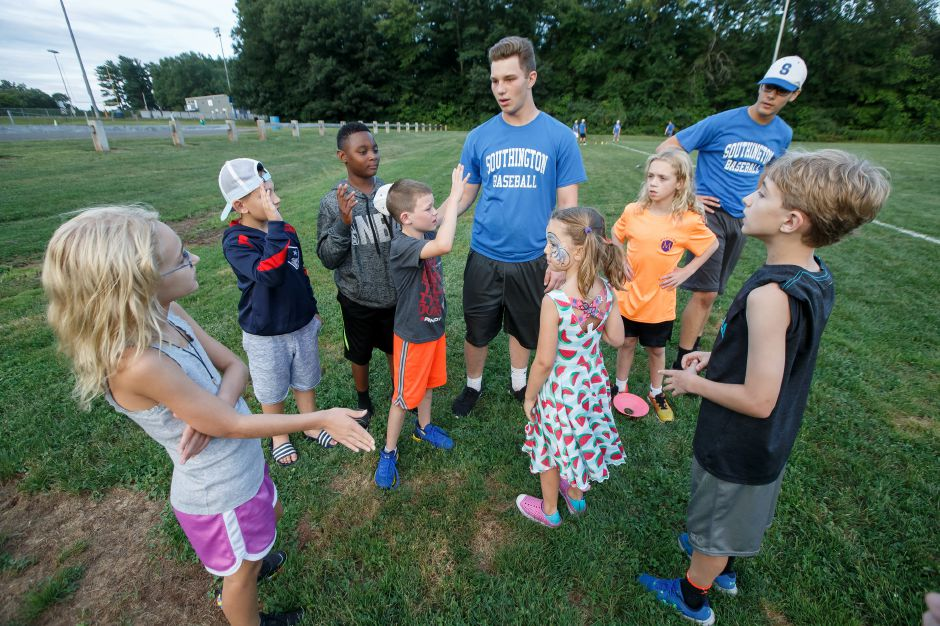 Kyle Leifert of the Southington baseball team organizes the kids team for whiffle ball game Saturday at the Southington Drive In hosted by Bread for Life in Southington September 1, 2018 | Justin Weekes / Special to the Record-Journal