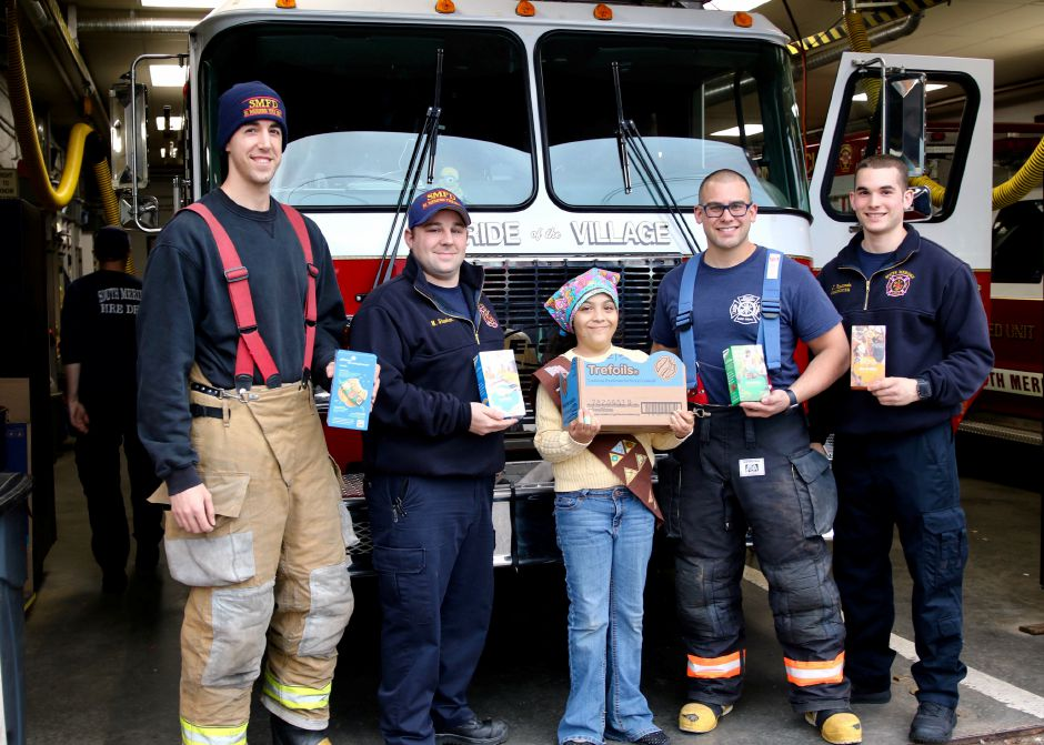 With Marielle are FF Brian Mischke, FF Mike Sheehan, FF Jake Gradwell, and FF Jake Papacoda.