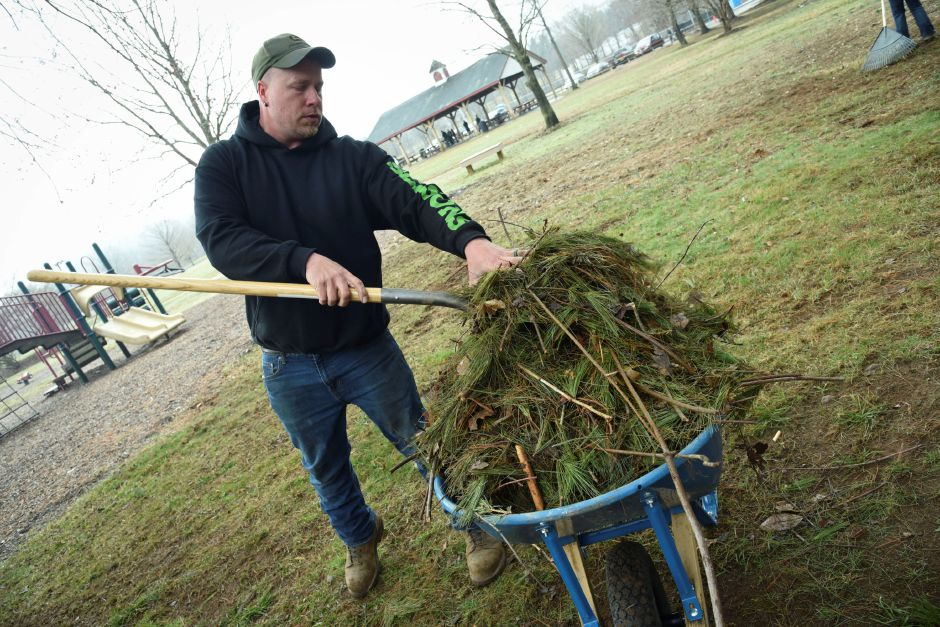 Ray McCarter, owner of Seasons Tree Service in Durham, helps clean up Allyn Brook Park, 50 Pickett Ln., on Saturday, April 6, 2019. | Bailey Wright, Record-Journal