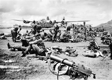 Airborne troops wait on the runway of an Okinawa airfield for the order to board planes for Japan, Aug. 29, 1945. They landed on Atsugi airfield near Tokyo. (AP Photo/Frank Filan)