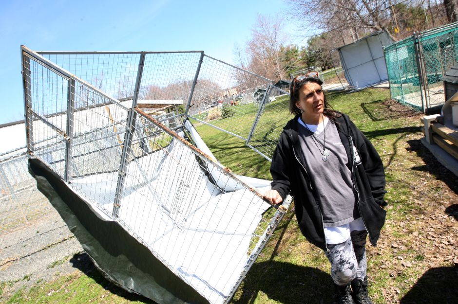 FILE PHOTO: Marlena DiBianco, director of the Meriden Humane Society, stands next to a toppled kennel - one of several vandalized and/or stolen recently at the shelter at 311 Murdock Ave., Thursday, April 16, 2015. | Dave Zajac, Record-Journal