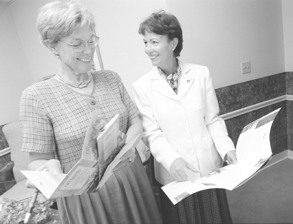 RJ file photo - Patricia Walden, right, executive director of Southington Care Center, goes over newly printed resident information brochures with Marijean Achilli, executive director of the Orchards at Southington, Sept. 1998.