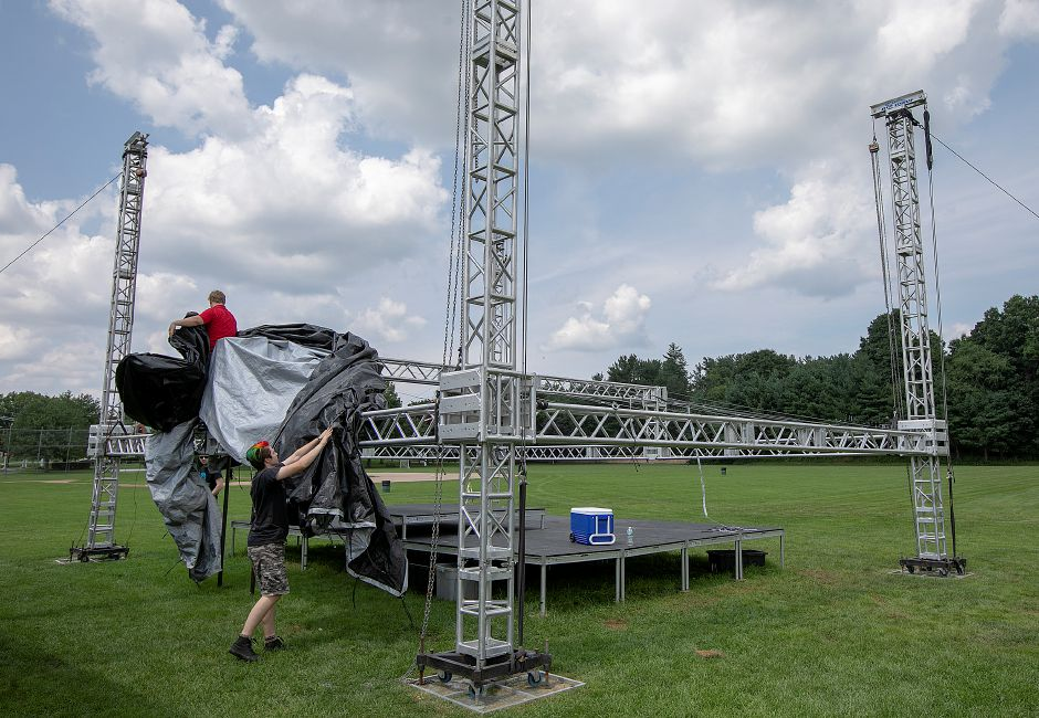 Workers for Roxbury based Big Wave Events prepare staging for an event at Bartlem Park in Cheshire, Friday, August 10, 2018. Richard Bartlem, the town's first parks department director and the namesake for Bartlem Park, is being remembered an active member of the local community. Bartlem died on Aug. 2 at 90 years old. Dave Zajac, Record-Journal