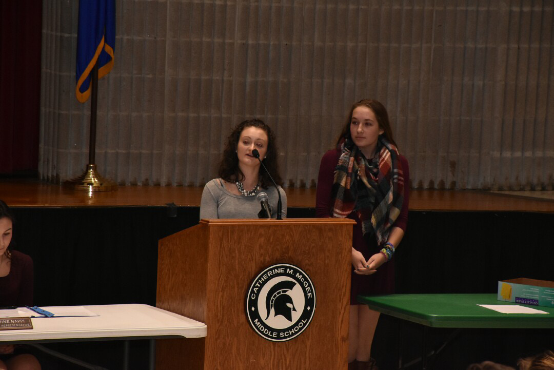 BHS seniors Nicole Cyr and Hannah Lavoie, Interact Club members, gave out dictionaries last month during a BOE meeting. | Kevin Cormack, contributed