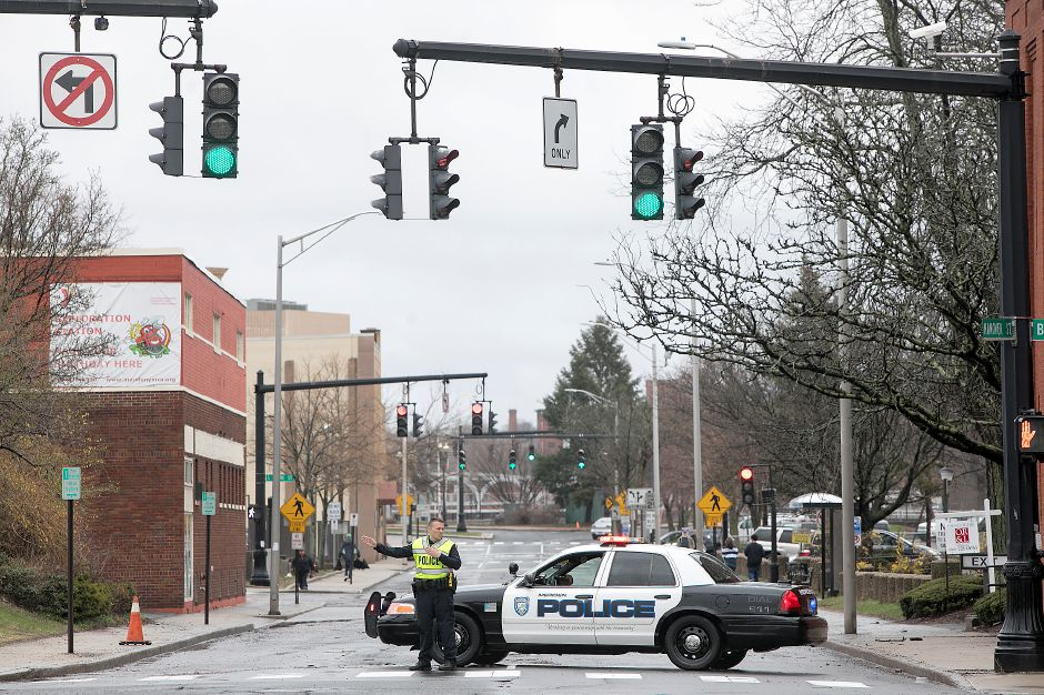Meriden police block off a section of Hanover Street as flood waters recede, Meriden, Monday, April 16, 2018. Dave Zajac, Record-Journal