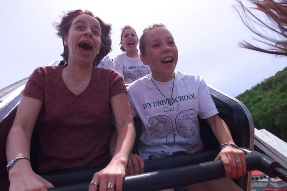 Anne Lundregan, left, a Record-Journal reporter takes her first ride on the Wild Cat, a roller coaster at Lake Compounce in Southington, with Amy Carlson, 10 of Bristol, a student at the park for the day from Bristol. Amy had been on many roller coasters and on the Wild Cat a few times already and was showing Anne, a new comer to roller coaster riding, the ropes, May 28, 1999.