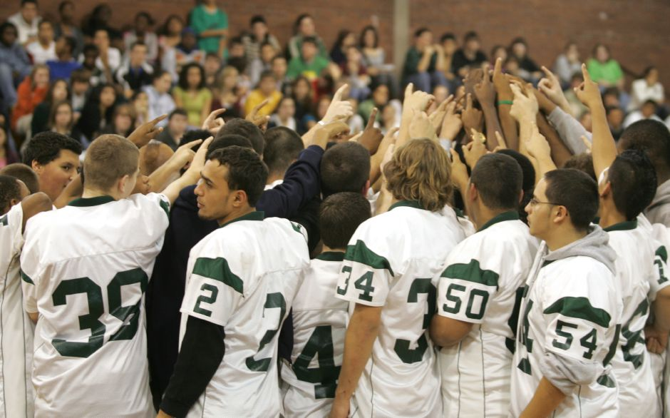 With the whole school watching, the Maloney High School football team gathers together during a pep rally at their school Friday afternoon. Maloney will play against New Canaan at S.C.S.U. Saturday night. Chris Angileri/Record-Journal.
