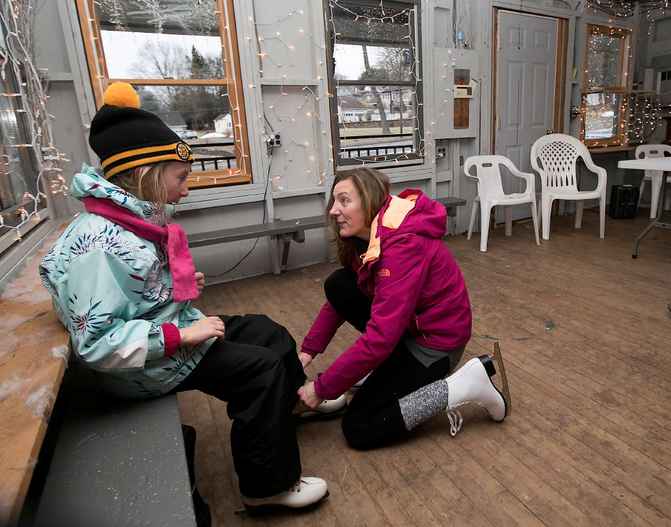 Marie Gaj, of Meriden, helps daughter, Jill, 6, lace up her skates in the skatehouse at Hubbard Park in Meriden, Monday, Jan. 15, 2018. For the first time in more than 10 years, Hubbard Park is open to public skating. Dave Zajac, Record-Journal