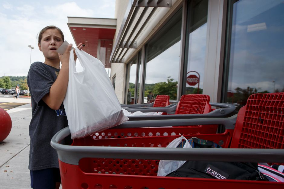 Cassie Plourde loads a donation into a cart Saturday during Southington
