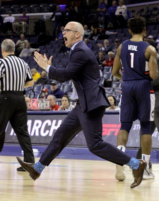 Connecticut coach Dan Hurley runs on the court during the first half of an NCAA college basketball game against Houston at the American Athletic Conference tournament Friday, March 15, 2019, in Memphis, Tenn. (AP Photo/Troy Glasgow)Troy Glasgow