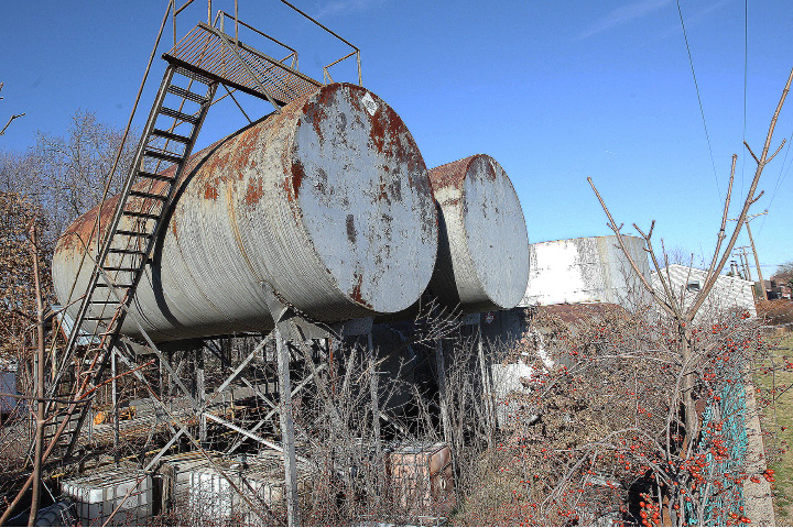 Oil drums along the linear trail near the intersection of West Center Street and Bristol Street in Southington, Wednesday, Jan. 6, 2016. Developers hope to transform the shuttered biodiesel refinery into boutiques and upscale restaurants.  |  Dave Zajac / Record-Journal