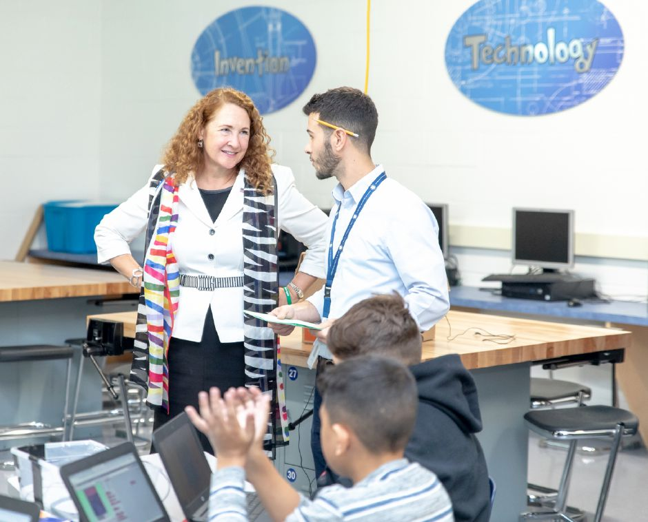 Representative Elizabeth Esty speaks to teacher Jason Giacco during a visit to the STEM lab at Lincoln Middle School in Meriden on Oct. 22, 2018. | Devin Leith-Yessian/Record-Journal