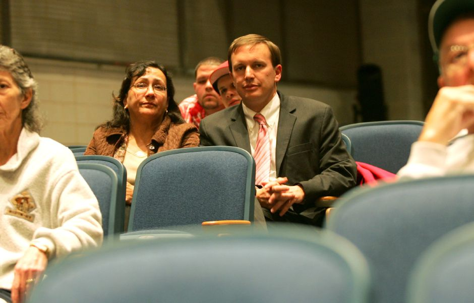 On the left is Hilda Santiago seated next to Chris Murphy in the audience. This is at the Candidate Debate and Forum held at Lincoln Middle School in Meriden Monday night October 30, 2006. Chris Angileri/Record-Journal.