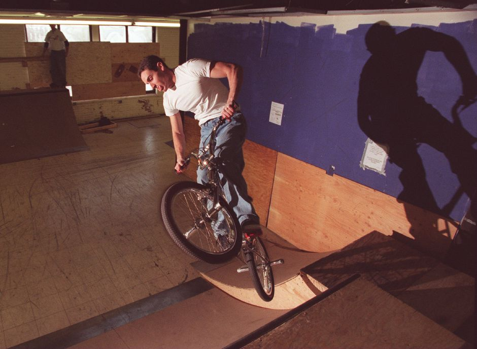 RJ file photo - Jeff Winston, a Sheehan High School math teacher, works on his quarter-pipe aerial bike maneuvers at teh new Extreme Skate Park in Wallingford, March 1999.