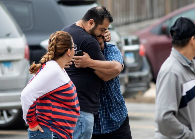 Arnulfo Ochoa, the father of Marlen Ochoa-Lopez, is comforted by a supporter as he walks into the Cook County medical examiner