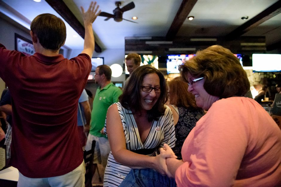 Meriden, CT - 07/18/2018: Sharon Milano (center) celebrates the results in Maloney