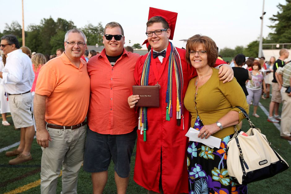 (From left to right) Joe Carroll, Ben Carroll, Andrew Carroll and Elyse Carroll pose together for a family photo after Andrew graduation from Cheshire High School on Friday June 21, 2013. (Matt Andrew/ For the Record Journal)