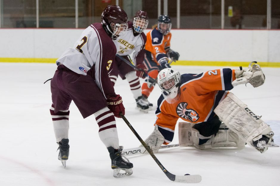 Sheehan and the Lyman Hall Co-op will renew their rivalry this coming Saturday night at Northford Ice Pavilion at 7:45 p.m. The Trojans took Round 1 in overtime. | Justin Weekes / Special to the Record-Journal