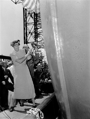 The $17,000,000 America, largest passenger ship ever constructed in America is christened at Newport News, Va., Aug. 31, 1939. First Lady Eleanor Roosevelt is shown smashing a bottle of Champagne on the bow of the 723-foot liner. (AP Photo)