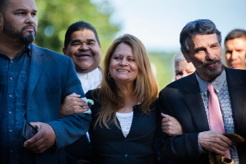 Nury Chavarria, center, stands between pastor Hector L. Otero, of Iglesia de Dios Pentecostal, left, and rabbi Herbert N. Brockman, of Congregation Mishkan Israel, on Wednesday, July, 26, 2017, in New Haven, Conn. Chavarria, a housekeeper and mother of four who received sanctuary in a Connecticut church, on Wednesday was granted an emergency stay of a deportation order that would have sent her back to her native Guatemala. (Lauren Schneiderman/Hartford Courant via AP)