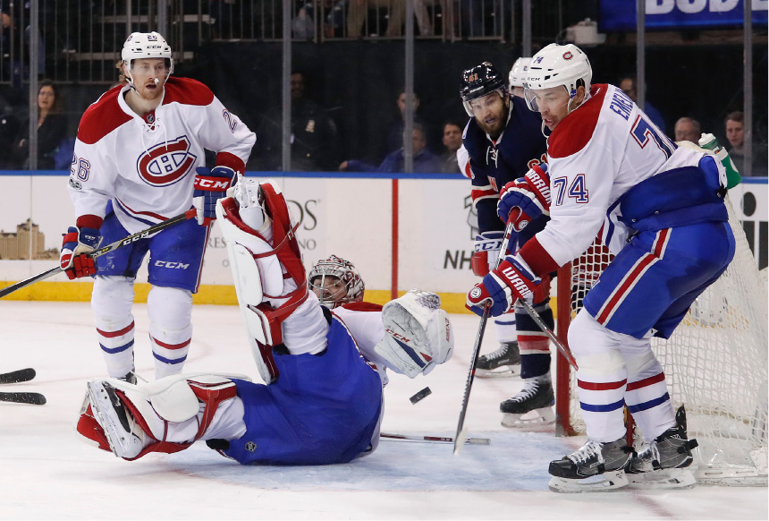 Montreal Canadiens goalie Carey Price (31) deflects a shot by the New York Rangers during the second period of an NHL hockey game, Saturday, March 4, 2017, in New York. (AP Photo/Julie Jacobson)