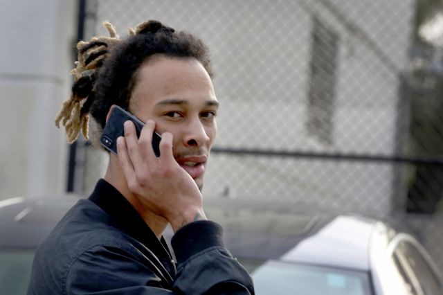 New York Jets wide receiver Robby Anderson makes a phone call in Fort Lauderdale, Fla., as he waits for a ride after being released from the Broward County Jail on Friday, Jan. 19, 2018. Anderson faces a slew of charges, including threatening a police officer
