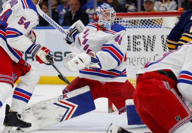 New York Rangers goalie Alexandar Georgiev (40) makes a save in traffic during the first period of an NHL hockey game against the Buffalo Sabres, Friday, Feb. 15, 2019, in Buffalo N.Y. (AP Photo/Jeffrey T. Barnes)