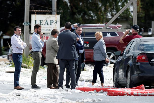 Maine Gov. Janet Mills , right, speaks to officials at the scene of an explosion Monday, Sept. 16, 209, in Farmington, Maine. Officials say a town