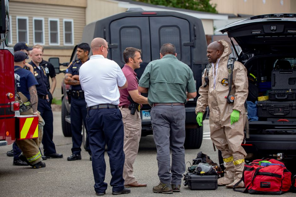 Emergency officials investigate a report of a suspicious substance found in the mail room of The Money Source in Meriden Sept. 21, 2018. | Richie Rathsack, Record-Journal