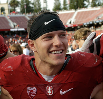 Stanford running back Christian McCaffrey smiles after Stanford defeated Oregon State, 26-15, in a game played in November. | Associated Press