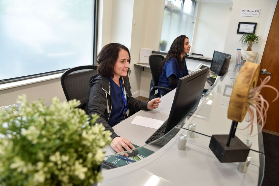 f60985ce8 Technicians Kristen Nieves, left, and Yaimelys Martinez work the front desk  at Willow Brook