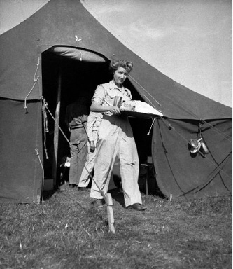 Lt. Bertha Miller, of Watkins, Iowa, head nurse of the 10th field hospital, leaves a ward tent with a tray of food as she cares for the wounded on the southern France front on August 29, 1944. The hospital is sixty miles inland from the beachheads. (AP Photo/Henry L. Griffin)