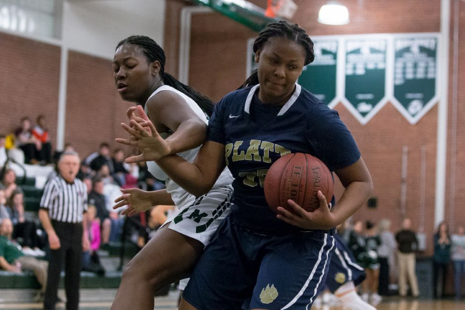 Platt sophomore Jalexia West, right, collected her fourth double-double in five games to help the Panthers turn back Courtney Ubaike and the Spartans 43-23 on Monday night on the West Side. | Justin Weekes / Special to the Record-Journal