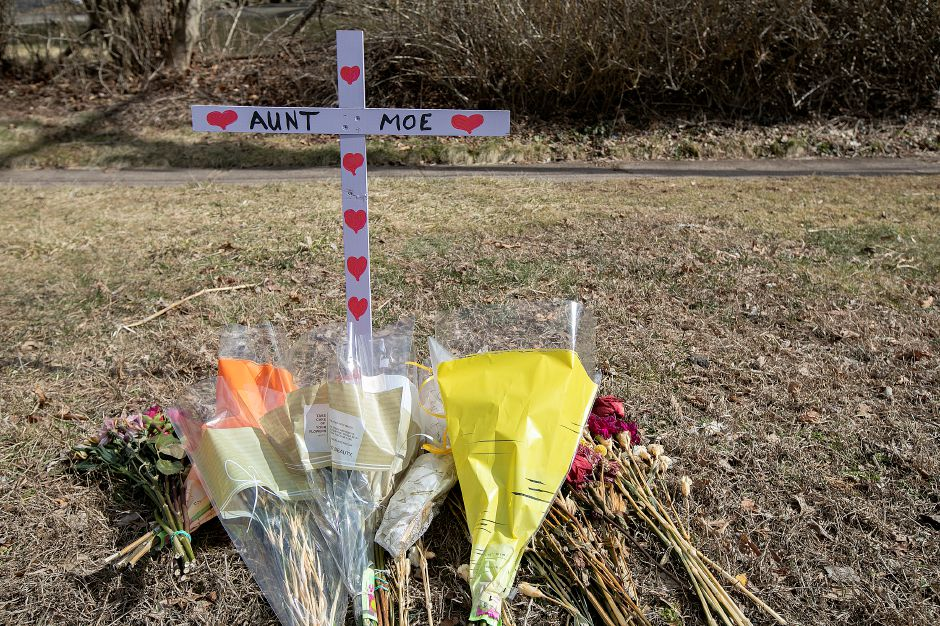 A roadside memorial for Maureen Munzner, 57, along Ridge Road near Hickory Hill Road in North Haven, Mon., Mar. 18, 2019. Munzner was walking on Ridge Road when she was struck by a red Ford Fusion Monday around 5:30 p.m. The car fled and Munzner was pronounced dead soon after the crash. Dave Zajac, Record-Journal