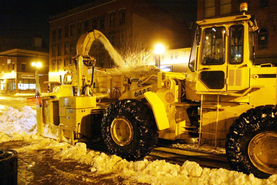 Meriden Public Works crews were hard at work at 1AM Thurs. morning removing snow from the sides of West Main St. in Downtown Meriden. They reportedly started working at 9:00 PM Wed. and were working through to 7:00 AM Thursday, Jan. 9. The snow was being dumped at the former Jefferson Middle School site on Center St.