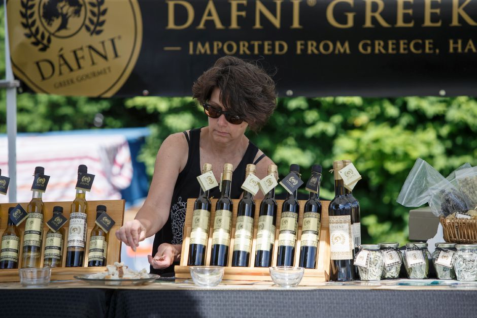 Tina Dorazio of New York sets up the Dafni Olive Oil display in the craft area Saturday during the 81st Annual Cheshire Strawberry Festival and Craft Fair on the Town Green in Cheshire May 31, 2016 | Justin Weekes / Special to the Record-Journal