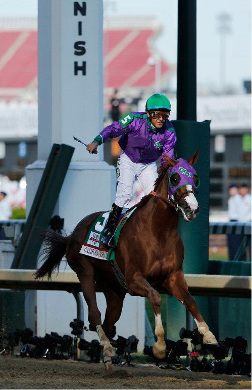 Victor Espinoza rides California Chrome to victory during the 140th running of the Kentucky Derby horse race at Churchill Downs Saturday, May 3, 2014, in Louisville, Ky.(AP Photo/Tim Donnelly)