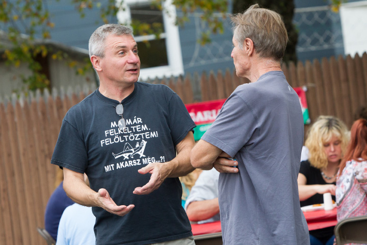 Rob Mike Mayer of New Hampshire left catches up with his brother Steve Mike Mayer of New Jersey Sunday during the Hungarian Festival at the Hungarian Community Club in Wallingford Sep. 18, 2016 | Justin Weekes / For the Record-Journal