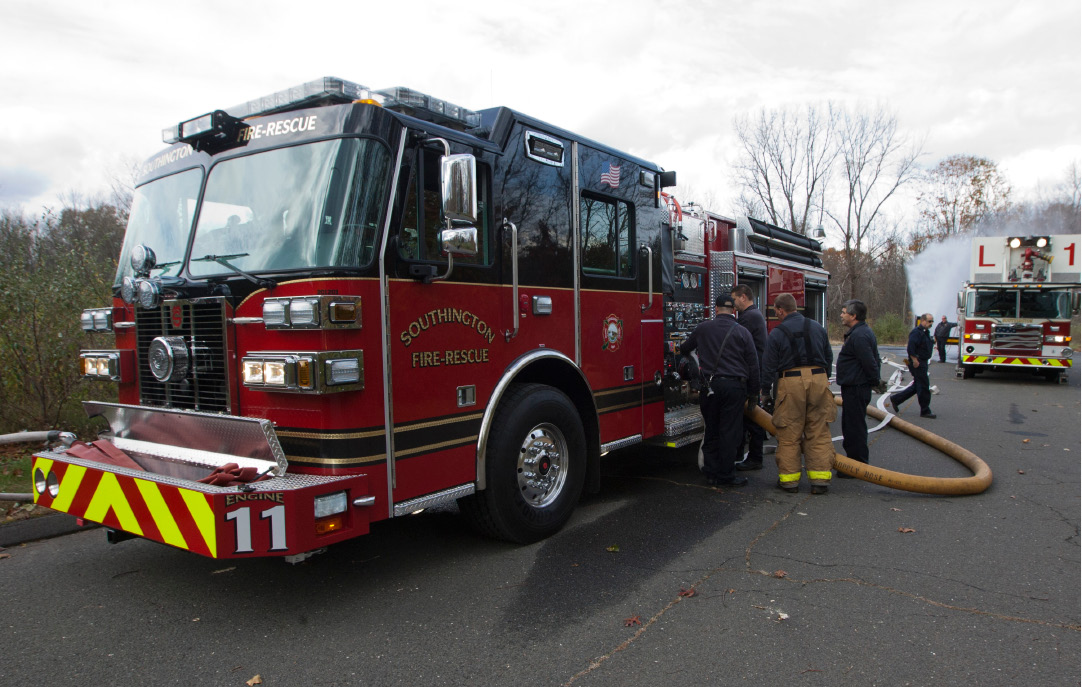 File photo - Firefighters get training on the pump controls of the Sutphen fire engine of the Southington Fire Department, Nov. 1, 2012. | (Christopher Zajac / Record-Journal)