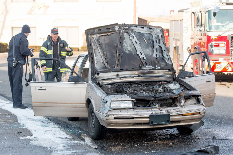 Emergency crews responded to a car fire on Slate Street by Camp Street in Meriden on Friday, Jan. 19. | Devin Leith-Yessian/Record-Journal